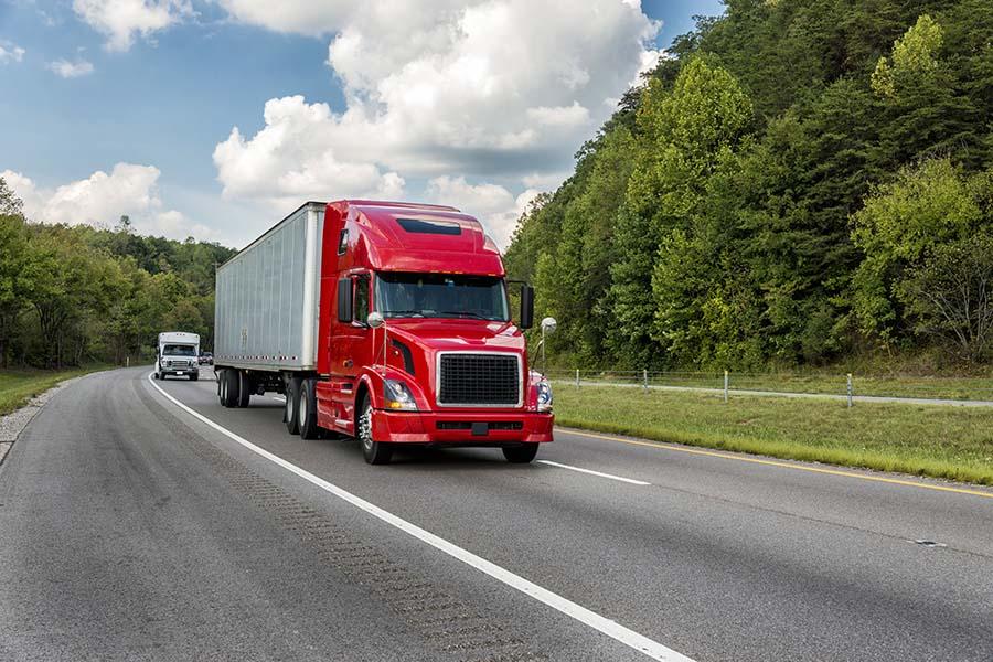 Header - Truck Driving On Highway